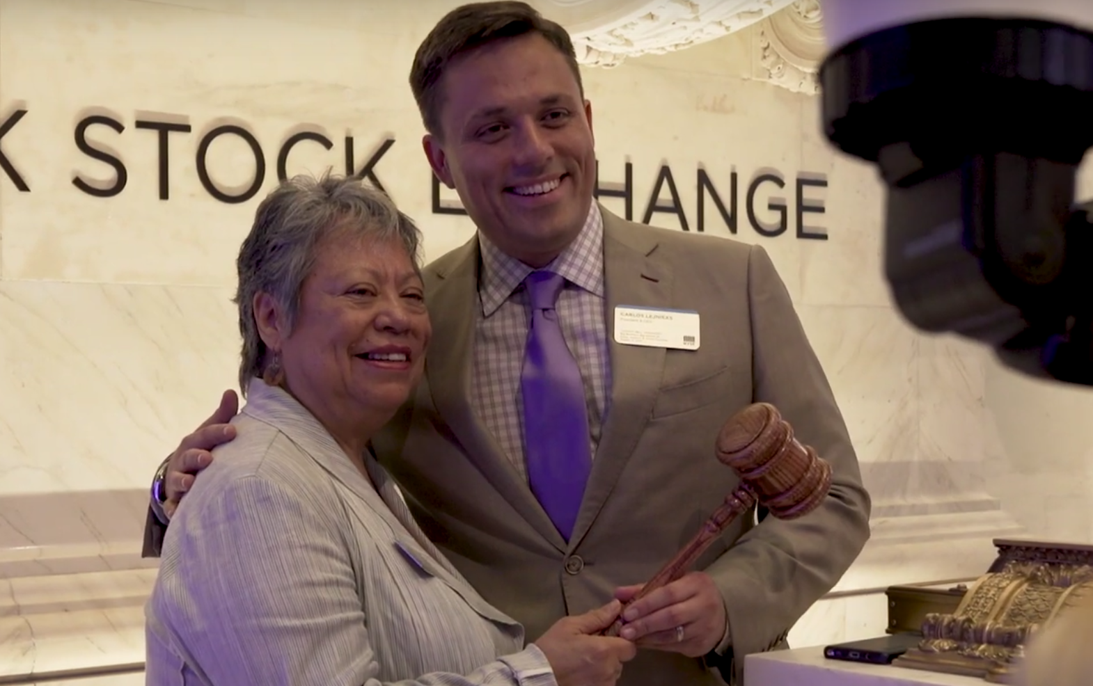 Carlos Lejnieks at Stock Exchange with Mother